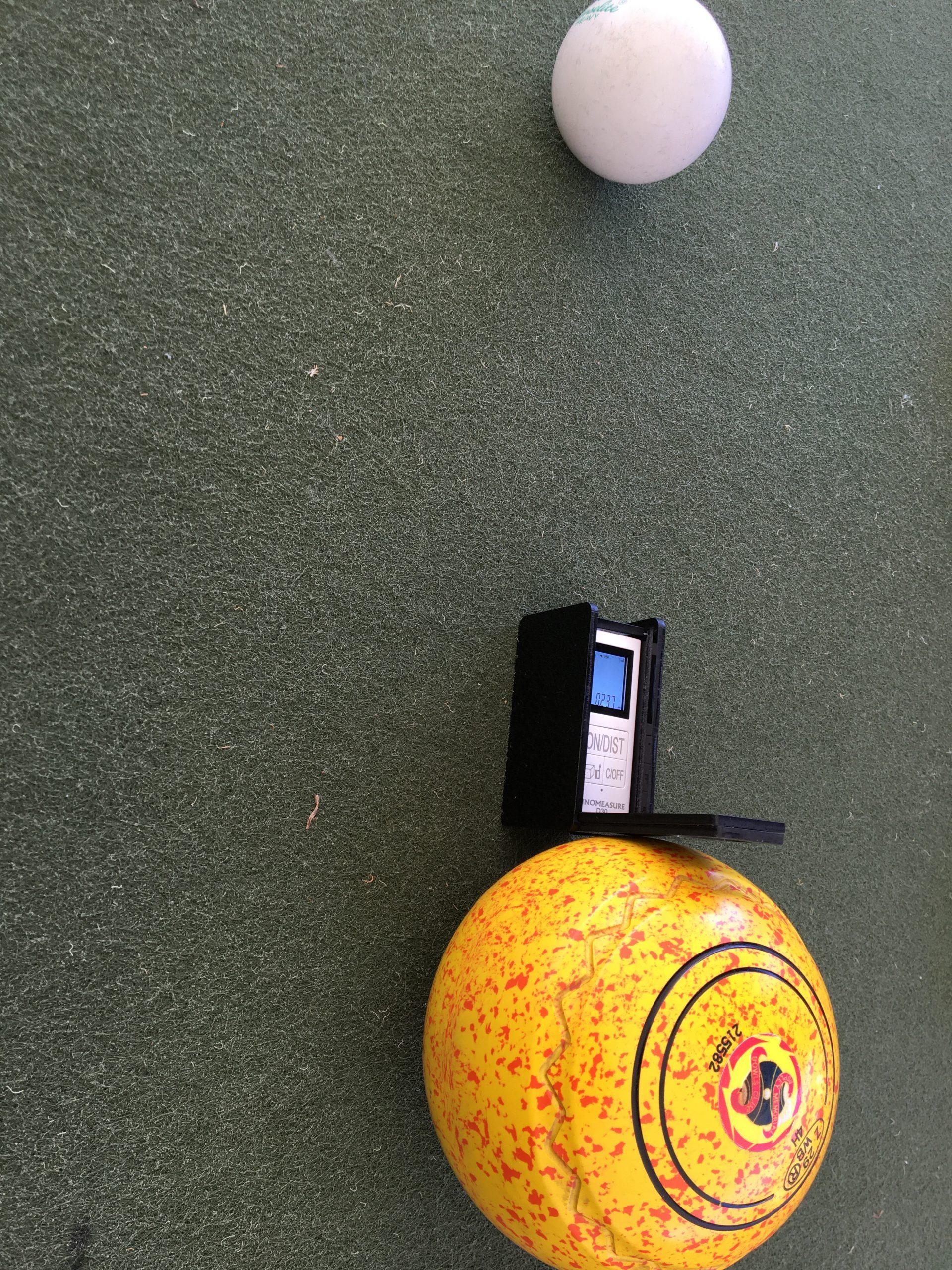 Bowls laser touching the target bowl